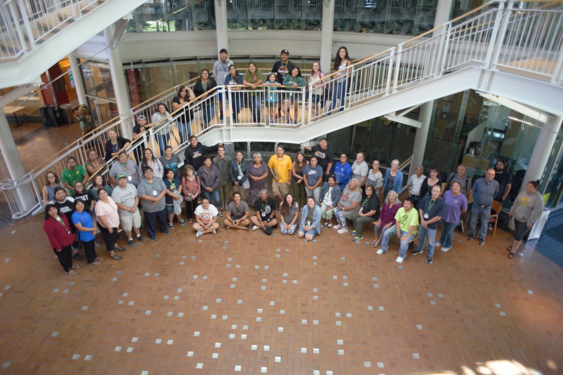 Indigenous language teachers and learners from throughout the Pacific Northwest and beyond gather for a group photo at NILI's face-to-face summer institute. Image courtesy of Northwest Indian Language Institute, University of Oregon.