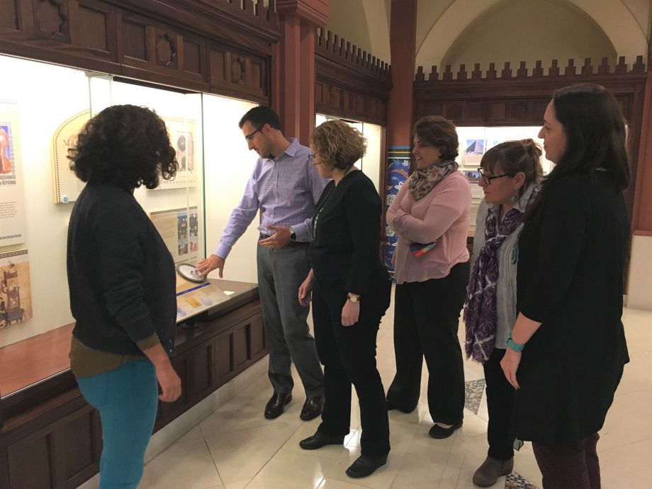 Scholars examine an exhibit at the Arab American National Museum. Image courtesy Arab American National Museum.