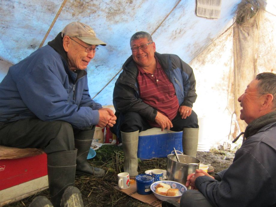 Calista Education and Culture director Mark John converses with Lawrence Edmund and Denis Sheldon on the lower Yukon River during a trip associated with the Yup'ik Historical Narratives project. Image courtesy of Ann Riordan.