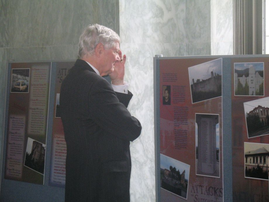 A visitor contemplates an exhibit created by the precursor to the Center for Bosnian Studies about Bosnian survivors of ethnic cleansing. Image courtesy of the Center for Bosnian Studies.