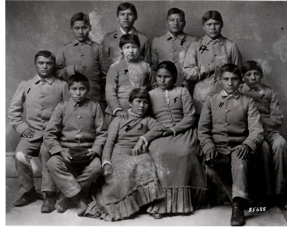"""An image from the """"Remembering Our Indian School Days"""" exhibition at the Heard Museum shows children entering a boarding school designed to assimilate Native Americans. Image courtesy of the Heard Museum."""
