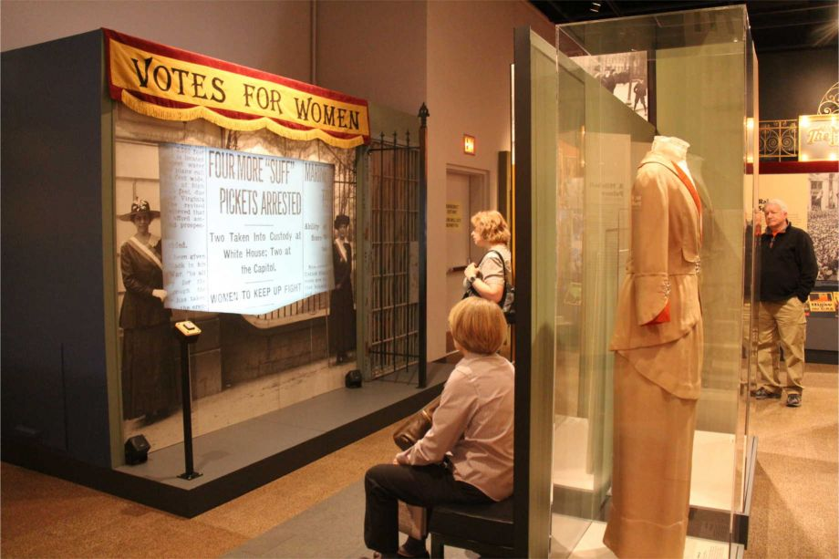 Visitors engage with an exhibit that explores women's suffrage in the United States during World War I.  *World War I America* was funded with an NEH grant. Image courtesy of the Minnesota Historical Society.
