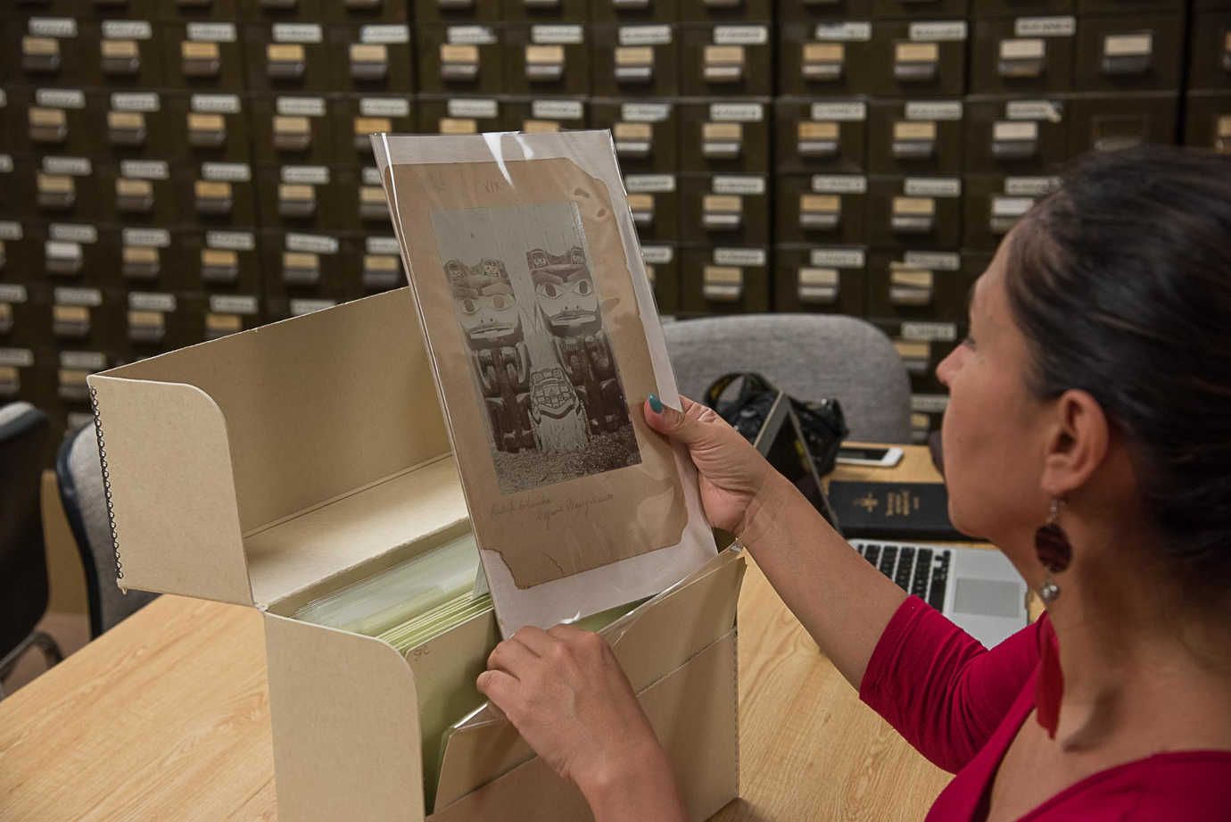 A Haida Language participant viewing an archived photo during National Breath of Life Archival Institute Module 1 at National Anthropological Archives, Suitland, MA. 2017. Photo Credit: Karen L. Baldwin