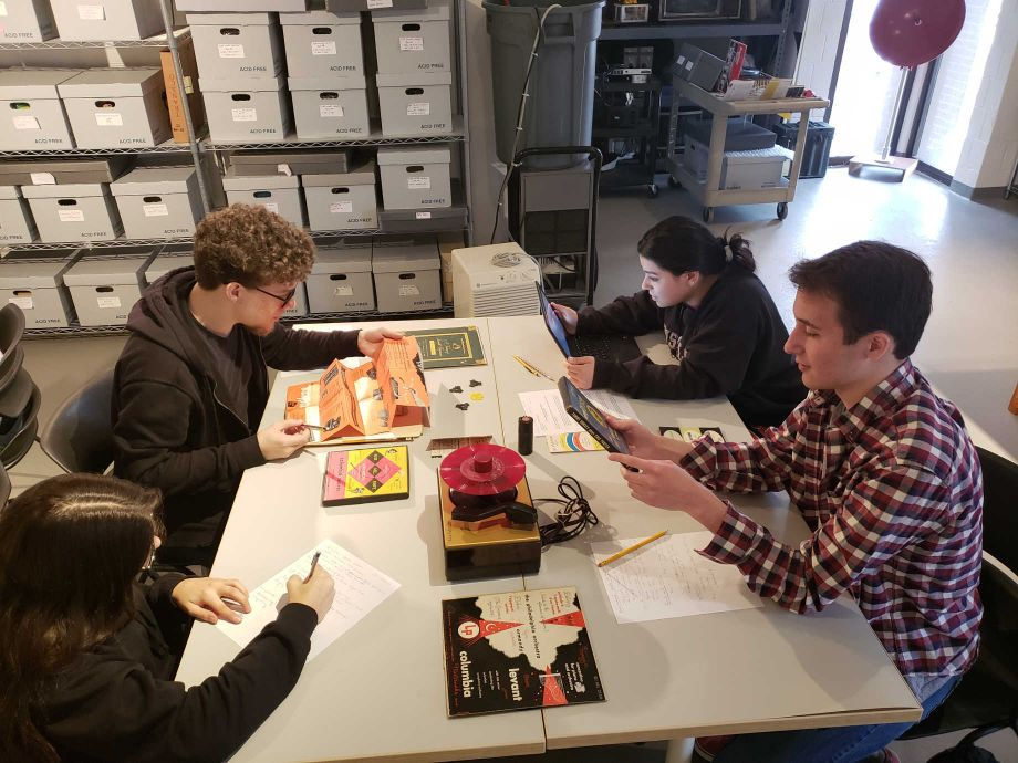 NEH funding has helped the Sarnoff Collection preserve its collection of audiovisual objects. Here, students explore items from the collection during a class visit. Image courtesy of the Sarnoff Collection.