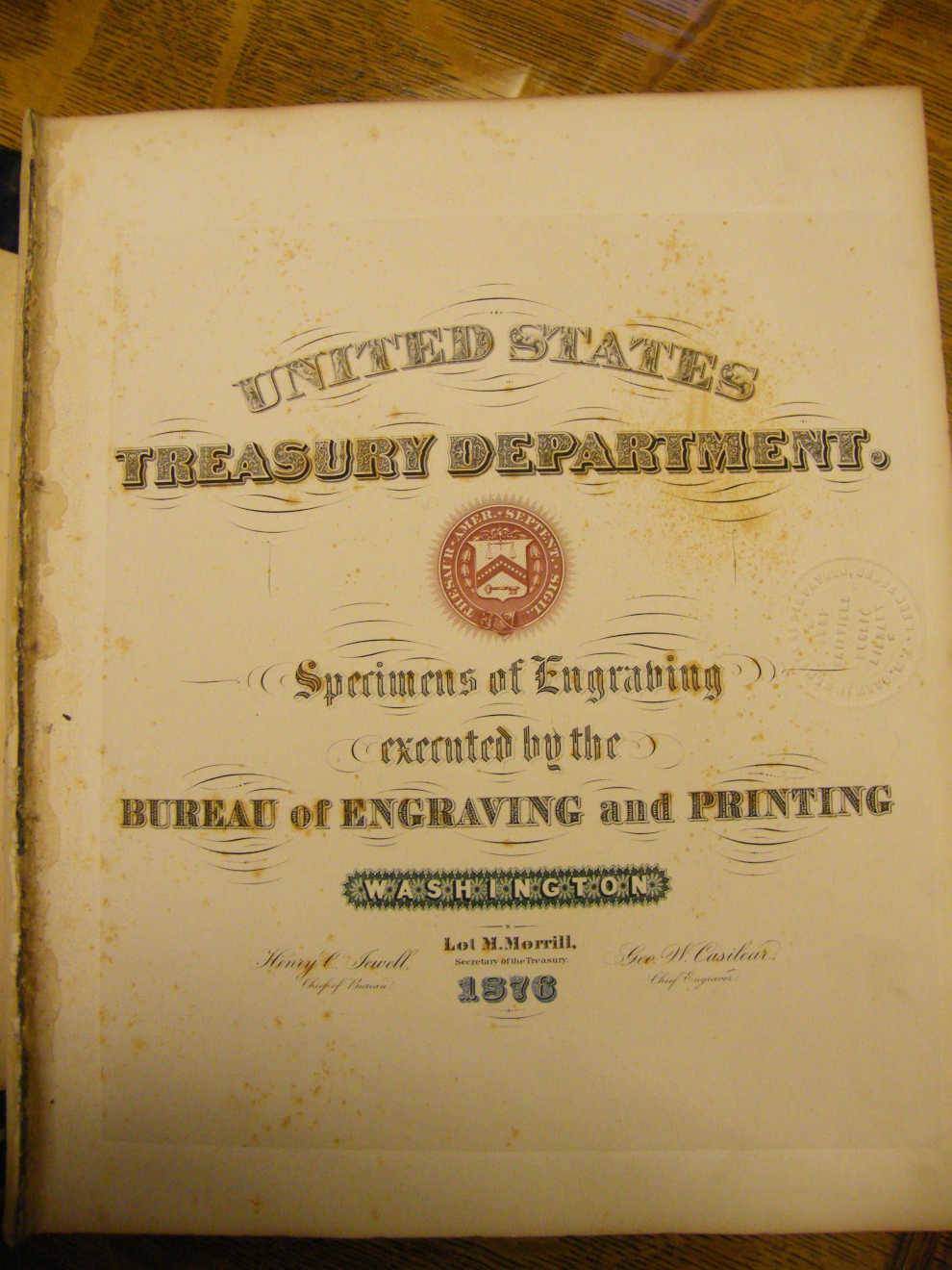 Title page of goldleaf, embossed Specimens of Engraving Book given to Colonel Franklin Drew by Lot Morrill, the 31st Secretary of the Treasury under Ulysses S Grant and the 28th Governor of Maine. Photo courtesy of Fort Fairfield Public Library.