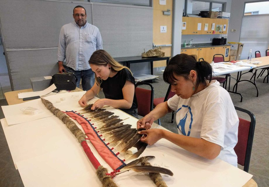 "Conservators from the Midwest Art Conservation Center offer workshops like ""Conserving and Cleaning Feathers: A Hands-On Introduction,"" ensuring that collections of indigenous artifacts are properly conserved. Image courtesy of the Midwest Art Conservation Center."