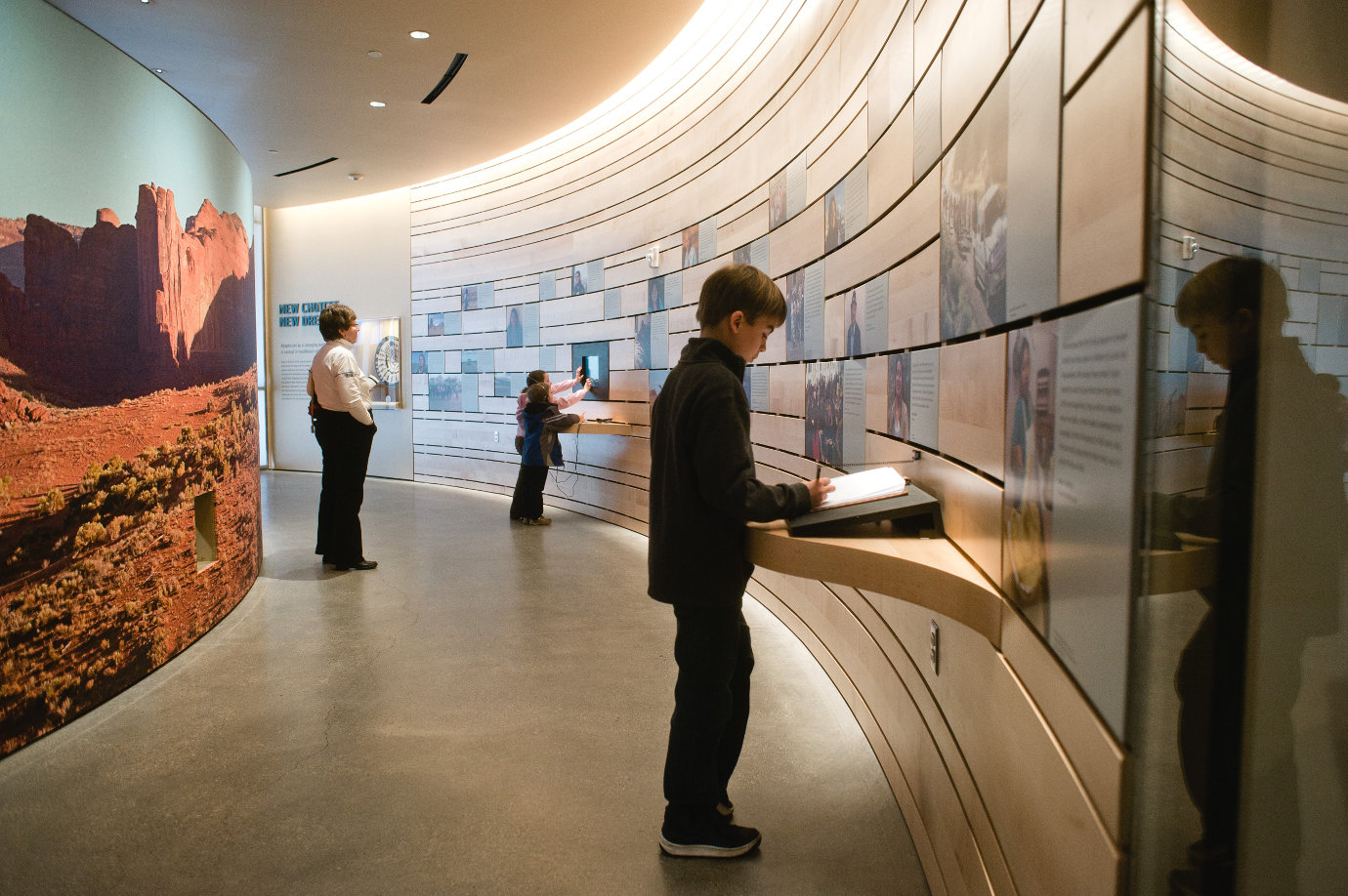 Children engage with interactive components of the *Native Voices* exhibition. Image courtesy of the Natural History Museum of Utah.
