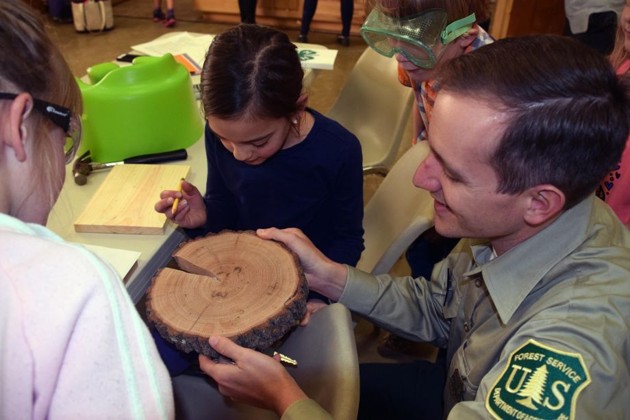 """As part of """"Our Heritage of Wood and Crafting,"""" a representative from the U.S. Forest Service helped 4-H youth learn about how people have used the local forests throughout history. Photo courtesy of Entrada Institute, Inc"""