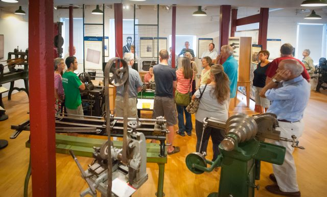 Visitors to the American Precision Museum participate in a gallery talk. Image courtesy of First Light Studios.