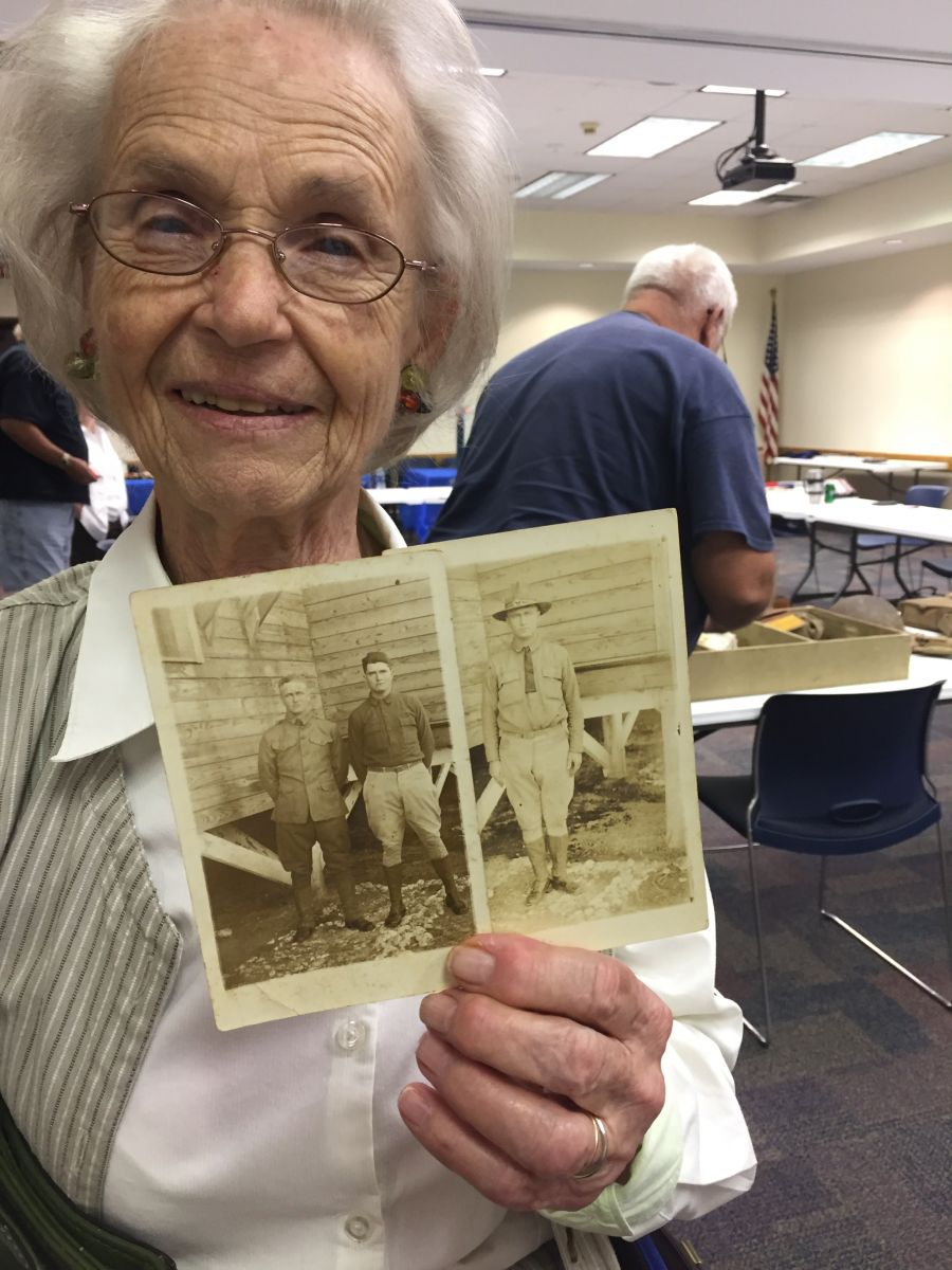 A participant in Auburn University's Dialogues on the Experience of War program shares family pictures. Image courtesy of the Caroline Marshall Draughon Center for the Arts & Humanities.