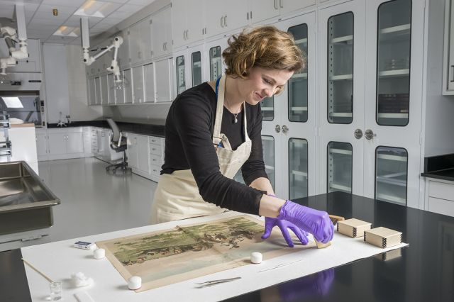 Joanna Didik, conservator, works in the paper conservation lab at the Helmerich Center for American Research at the Gilcrease Museum.  Image courtesy of the Gilcrease Museum.