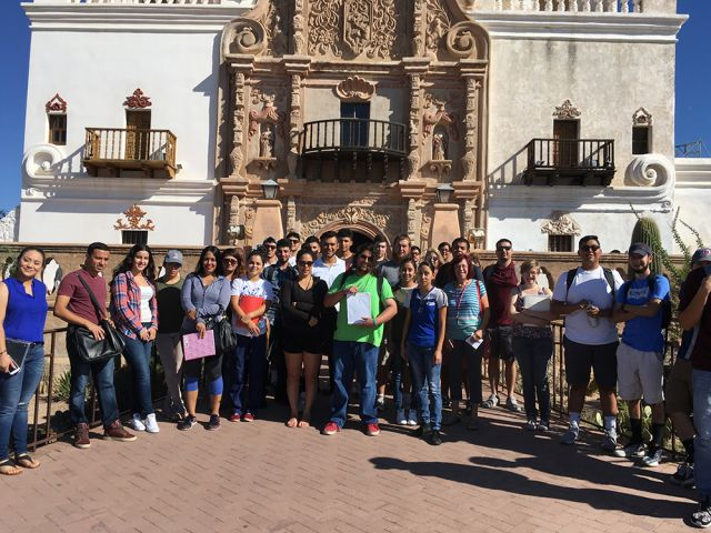 """Students participating in """"Border Culture in the Classroom and the Public Square"""" on a trip to the Mission San Xavier del Bac in Tucson, Arizona. Image courtesy of Pima County Community College."""