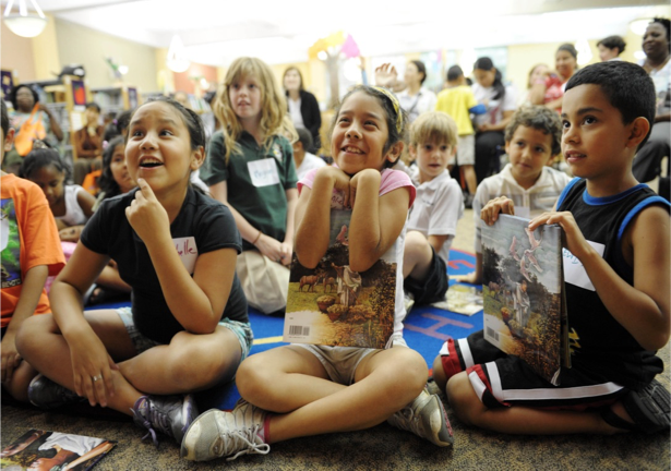 Participants in a PRIME TIME Family Reading program listen to a storyteller. Image courtesy of the Louisiana Endowment for the Humanities.