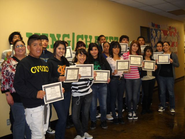 A Story Talk group in a San Diego high school receives certificates acknowledging their completion of the program. Image courtesy of People & Stories/Gene Y Cuentos.